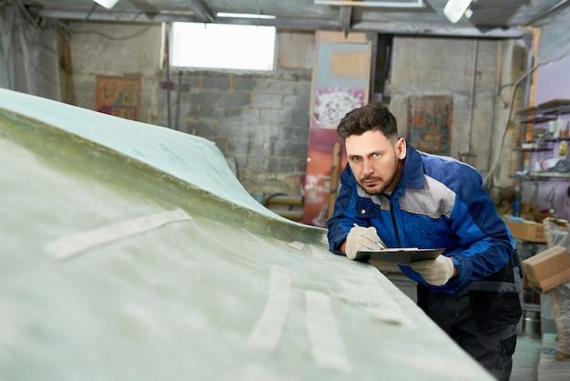 Man working in boat maintenance shop