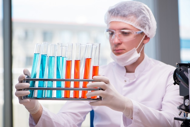 Man working in the chemical lab on science project