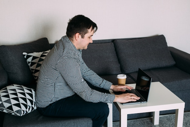 Man working on computer at home
