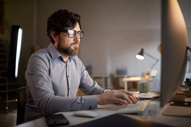 Man working on computer at office