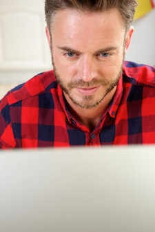 Man working behind computer screen