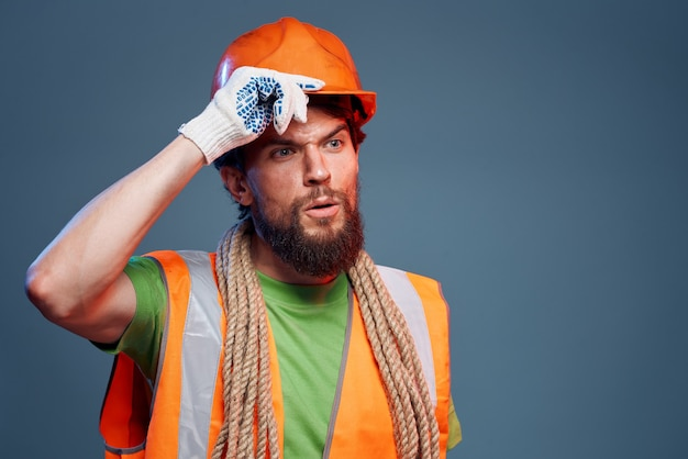 Man working construction forum orange helmet safety hard work