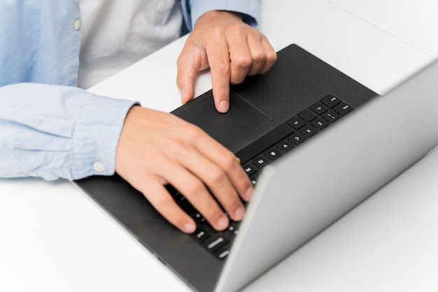 Man working on energy innovations on his laptop