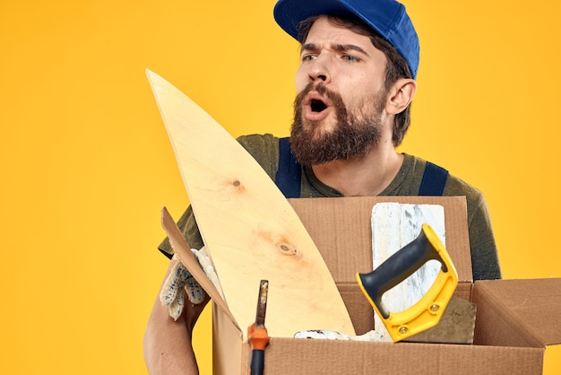 A man in a working form a box with loading tools yellow space.