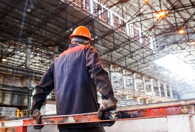 A man in a working form on the of a metallurgical plant.