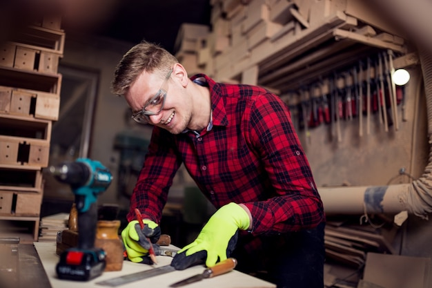 Man working hard in his workshop