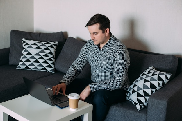 Man working home on computer
