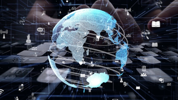 グローバル接続のグラフィックでコンピューターで作業する男性