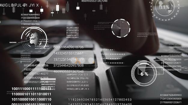 Человек, работающий на клавиатуре портативного компьютера с графическим пользовательским интерфейсом