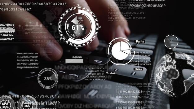 그래픽 사용자 인터페이스가있는 랩톱 컴퓨터 키보드에서 작업하는 사람