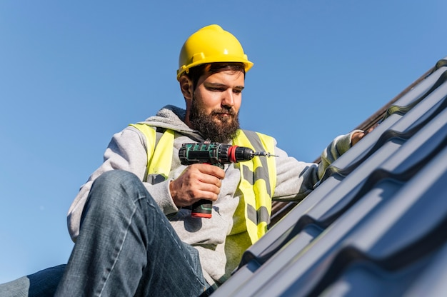 Man working on roof front view