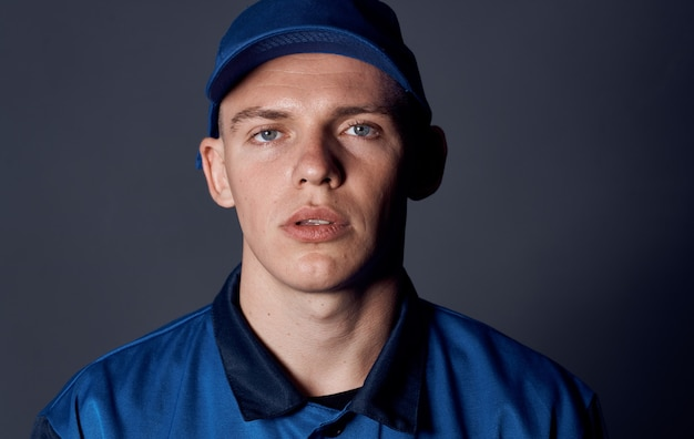 Man in a working uniform blue cap work delivery service