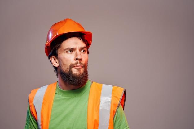 Man in working uniform orange paint safety work