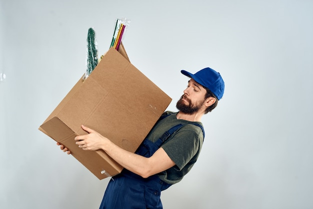 Man in working uniform with boxes in hands delivery loading lifestyle