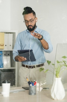 Man working while checking his device