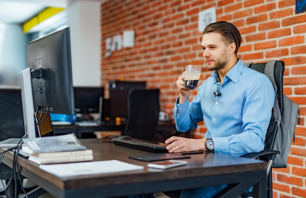 Man working with computer at company office.
