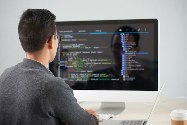 Man working with new application