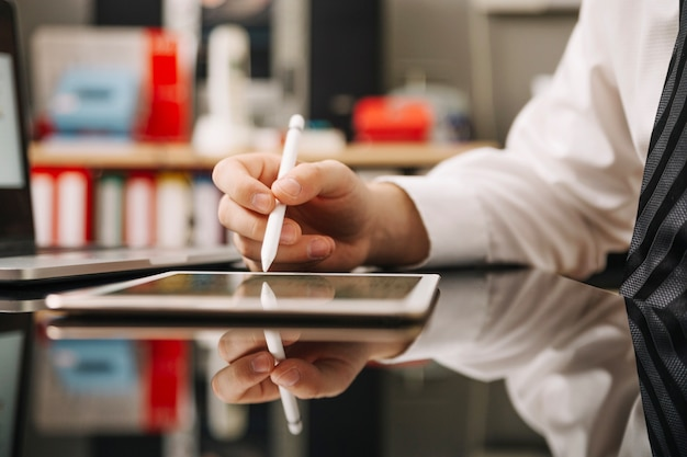 Man working with pencil and tablet