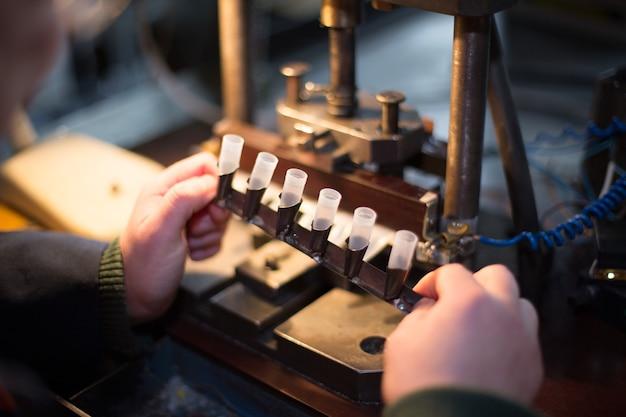 Man works at old manual equipment