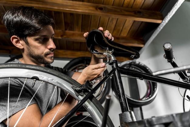 Man in workshop creating bike