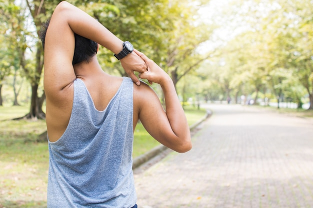 Man worming up and exercising before running