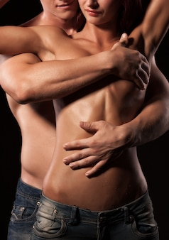 Man wrapping arms around girlfriend body