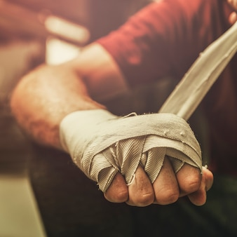 Man wrapping his hand, ready for boxing
