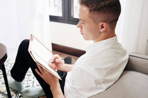 Man writing down thoughts and creative ideas