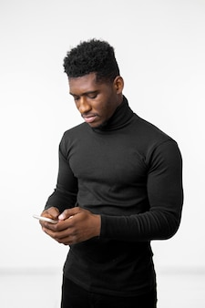 Man writing a message on mobile phone