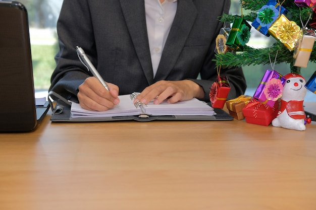Man writing reminder schedule note on notebook.