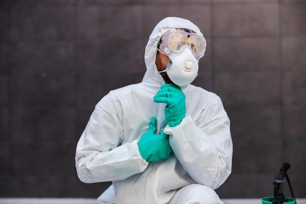 Man in zipping sterile protective uniform. prevention form spreading corona virus concept.