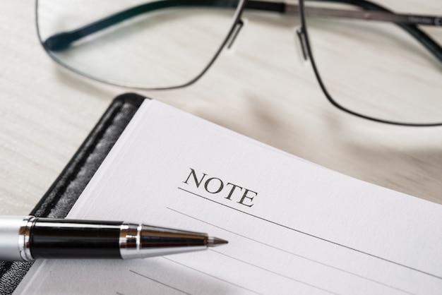 Management concept, pen over an open agenda