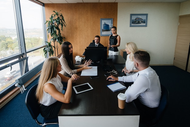 The manager discusses business issues with his staff. business, finance