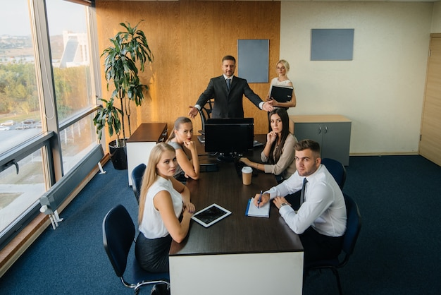 The manager discusses business issues with his staff