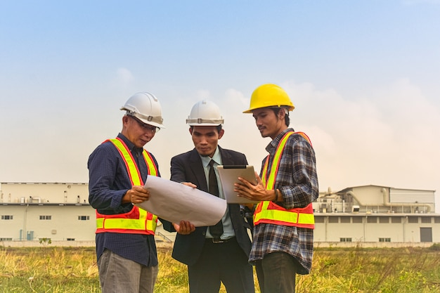 Manager project communication with foreman supervisor check on blueprint estate building construction