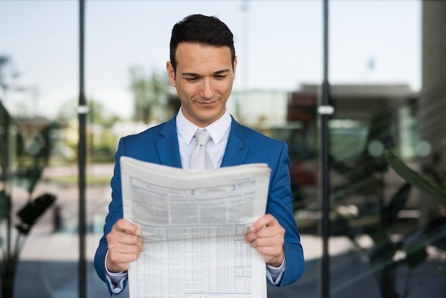Manager reading the newspaper