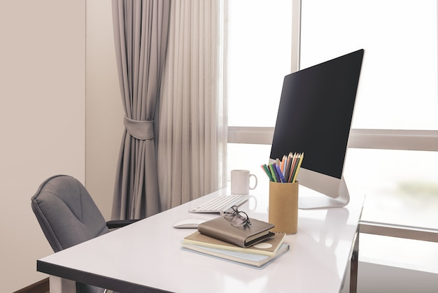 Manager table with desktop computer and business notes