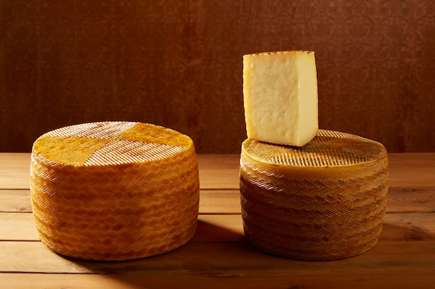 Manchego cheese from spain on wooden table