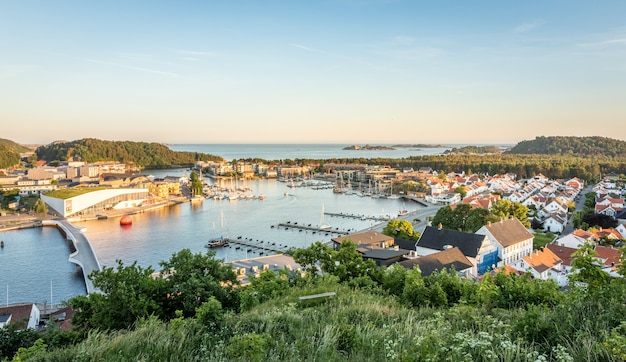 Mandal, a small city in the south of norway. seen from a height, with the sea and the sky in the background.