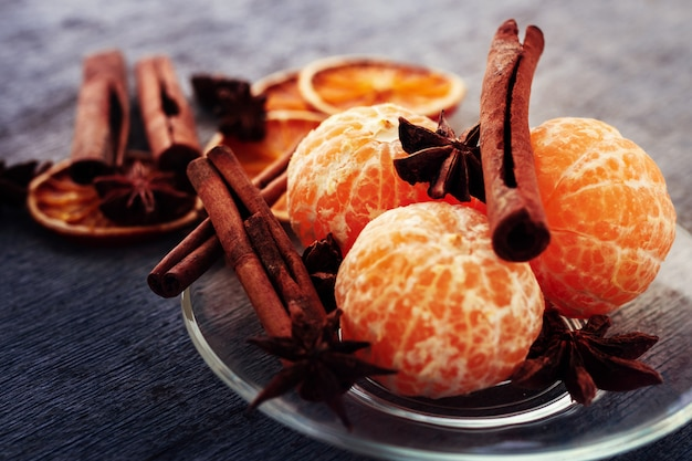 Mandarin, cinnamon sticks and anise on a plate