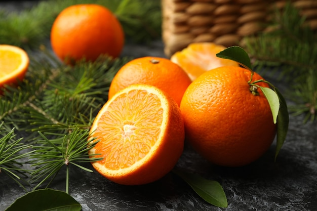 Mandarins, pine branches and basket
