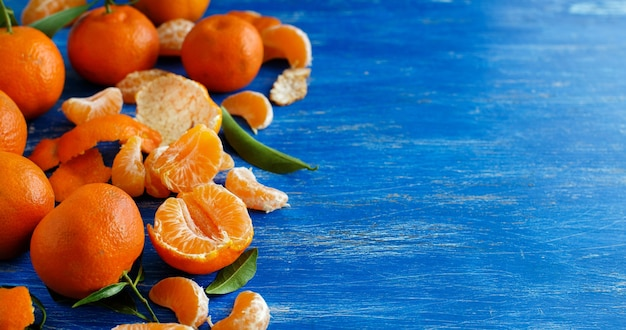 Mandarins with leaves on a bright blue background