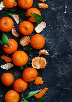 Mandarins with leaves on a dark background