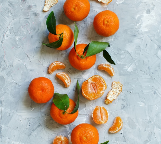 Mandarins with leaves  on a grey background
