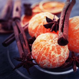 Mandarins without peel lie on a plate with anise