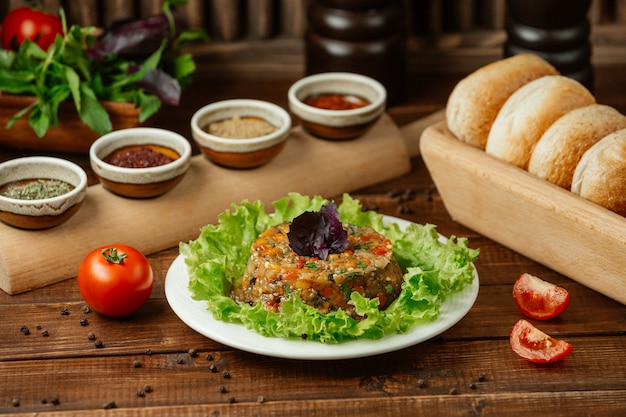 Mangal salad,mix of grilled eggplants, tomatoes and bell peppers with garlic served with different sauces