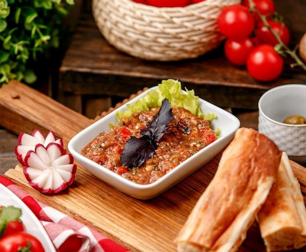 Mangal salad on wooden board