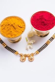 Mangalsutra with huldi kumkum and mogra flowers, selective focus