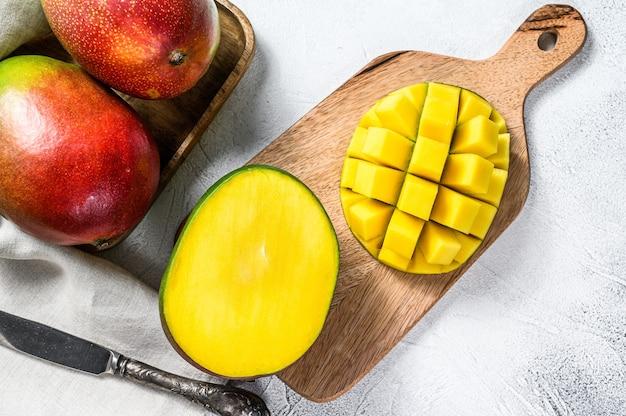 Mango fruit cut into cubes on a cutting board