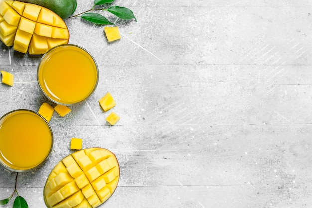 Mango juice in glass. on white rustic background
